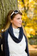 autumn park - fashion woman with sunglasses - stock photo