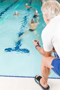 pool coach - swimmer training competition - stock photo