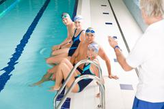 swimming pool - swimmer training competition - stock photo