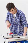 home improvement - handyman cut tile - stock photo