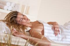 Spa - young woman at wellness massage relaxing Stock Photos