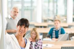 high school - three students with mature professor - stock photo