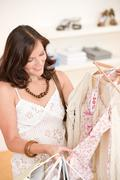 Stock Photo of fashion shopping - happy woman choose sale clothes