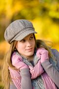 Autumn park - fashion model woman wear cap Stock Photos