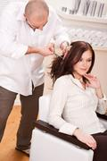 professional hairdresser cut with scissors at salon - stock photo