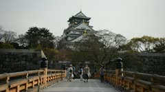 People Visit Osaka Castle Park Pedestrian Cross Arch Bridge Sightseeing Landmark Stock Footage