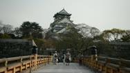Stock Video Footage of People Visit Osaka Castle Park Pedestrian Cross Arch Bridge Sightseeing Landmark