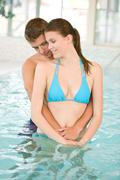 Young loving couple relax in swimming pool Stock Photos