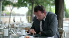 Happy businessman drinking coffee in the restaurant Stock Footage