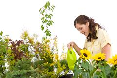 Gardening - woman pouring plants with watering can Stock Photos