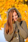 autumn sunset park - red hair woman fashion - stock photo