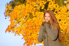 autumn sunset park - red hair woman fashion - stock photo