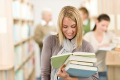 High school library - happy student with book Stock Photos