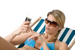 Beach - happy woman relax in bikini with music Stock Photos