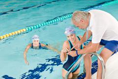 Pool coach - swimmer training competition Stock Photos
