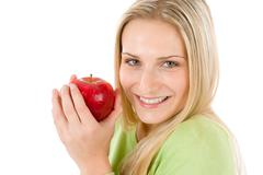 healthy lifestyle - woman holding red apple - stock photo