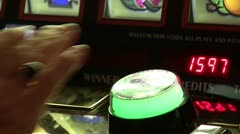 Playing the slot machines in casinos - stock footage