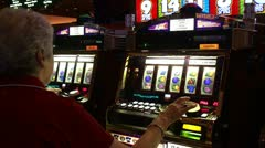 Playing the slot machines in casinos Stock Footage