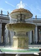 A fountain at the Vatican, Piazza of St. Peter. - stock photo