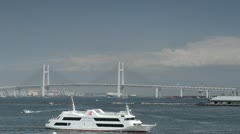 Yokohama Bay Bridge Tokyo Ferry Boat Passing Ferryboat Port Harbor Cruise Ship Stock Footage