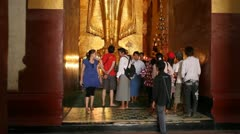 Visitors inside pagoda in Bagan Stock Footage