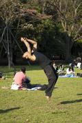 Man doing a back flip in Yiyogi park, Tokyo Stock Photos
