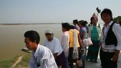 Activity near Buphaya Pagoda on Irrawaddy River Stock Footage