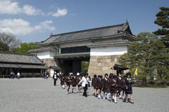 Japanese school outing to Nijojo temple in Kyoto, Japan. - stock photo