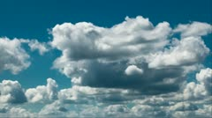 Clouds on blue sky at midday Stock Footage