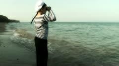 Sailor boy looks at sea Stock Footage