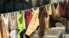 Washing blowing in an indian street Stock Footage