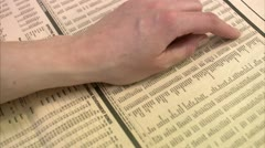 Stock exchange list in a paper Stock Footage