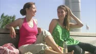 Two friends enjoying the sun Stock Footage