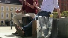 Two men having a break, having  ice-cream cones Stock Footage