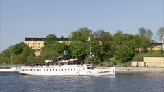 Boat passing by Skeppsholmen, Stockholm Stock Footage