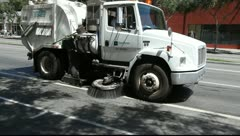 Sweeper Truck cleaning the street for dirt and other debris Stock Footage