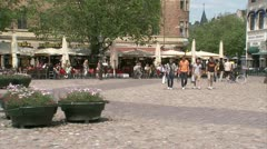 Four young men with shopping bags walking in the centre of Malmo - stock footage