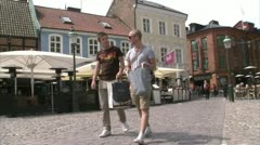 Two young men walking in the centre of Malmo Stock Footage