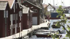 Boats and fishing-huts in Smogen Stock Footage