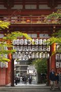 Japanese paper lanterns in large archway of a temple Stock Photos