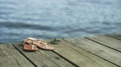 Stock Video Footage of Sandals on a jetty