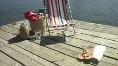 A sun chair on a jetty Stock Footage