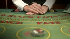 Winning when playing cards at a gambling table - stock footage