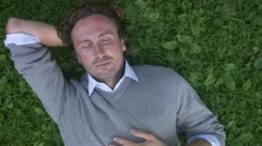 A man resting in a park Stock Footage