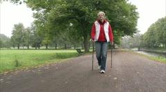 A woman pole walking Stock Footage