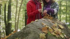Mother and daughter picking mushrooms Stock Footage
