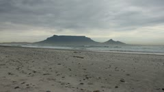 Table Mountain from Bloubergstrand in heavy stormy weather Stock Footage