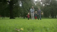 Senior man, woman and children going for a picnick Stock Footage