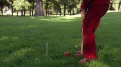 A blond girl playing croquet - stock footage