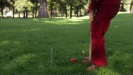 Stock Video Footage of A blond girl playing croquet